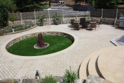 <h5>Water Feature Garden</h5><p>A plum slate monolith used as a center piece for this stunning garden </p>