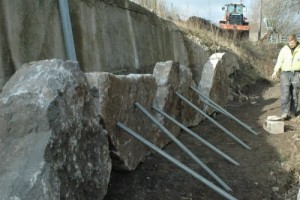 Limestone rocks being supported before concreting in place